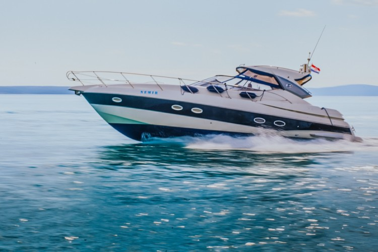 blurred speed yacht cruise daily rent a boat
