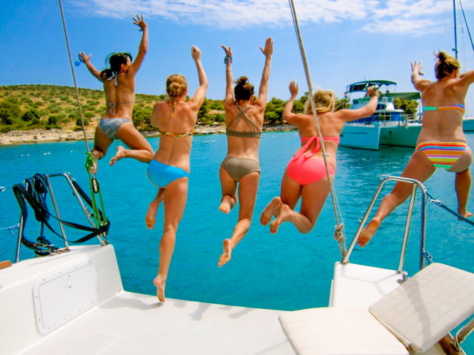 party sailing boat hen party jump into sea dive into summer holiday